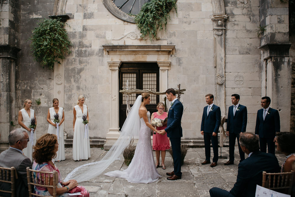 Bride and Groom during their ceremony in Saint Mark Church in Hvar in Croatia