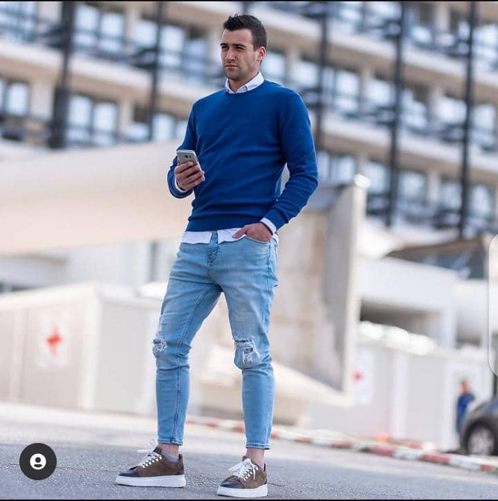 man stepping out in casual outfit