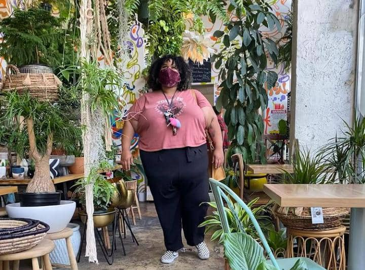 plus sized lady stepping out in casual outfit