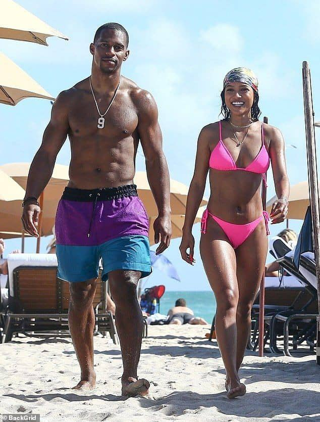 guy in shorts with lady in bikini at the beach