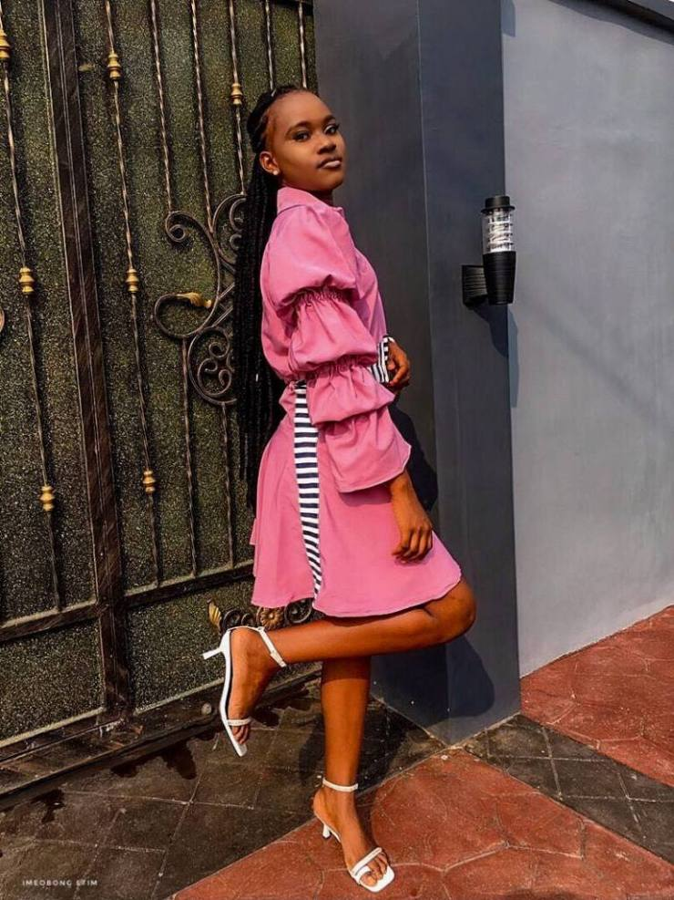 Victoria in pink dress with statement sleeves