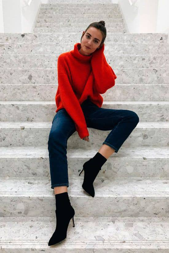 lady wearing red polo neck with heels