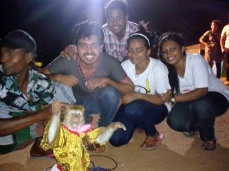 The gypsy guy let us take a picture with the adorable monkey who knows how to pose with a high 5!