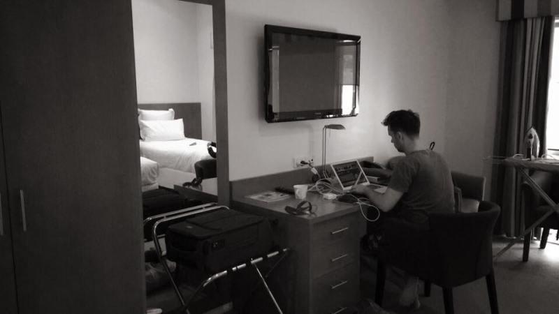 Matt Scott in hotel room working on laptop