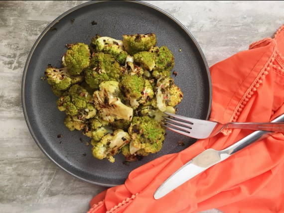Side dish of green cauliflower with capers