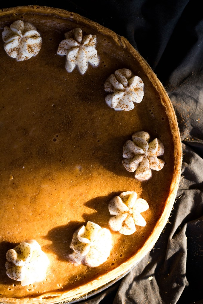 Beautiful sweet potato pie or tart with whipped cream topping