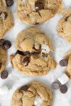 Peanut butter S'mores cookie recipe cut in half with gooey marshmallow center
