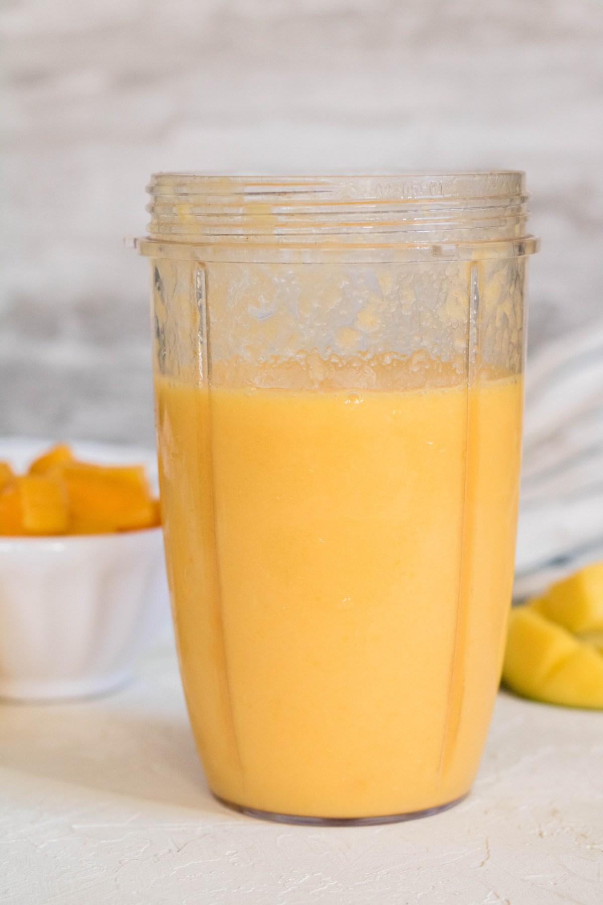 Blended orange mango smoothie