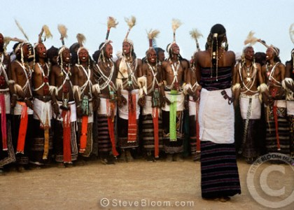 Wodaabe tribe' s girl choosing a partner from the performing men during the Gerewol Festival, north of Abalak, Nigeria.