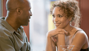 man-and-woman-flirt-over-drinks