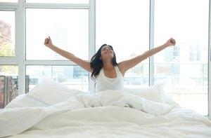 woman-waking-up-motivated-lwadann-tardif-getty