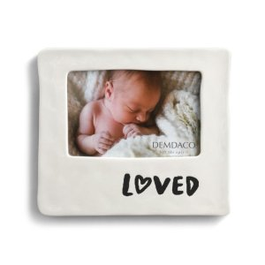 "Demdaco <a href=""https://lifestylesgiftware.com/product/demdaco-black-and-white-loved-frame/"">Black and White Loved Frame</a>"