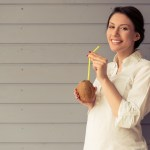Pregnant woman drinking coconut milk