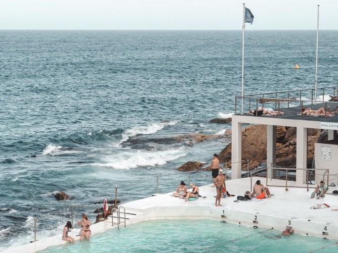 people chilling in iceberg pool on bondi beach
