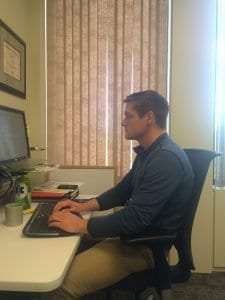 Example of poor posture at a desk