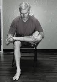 man sitting with legs crossed