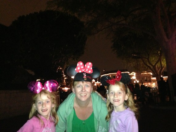 Wearing our ears with Mum in Disneyland