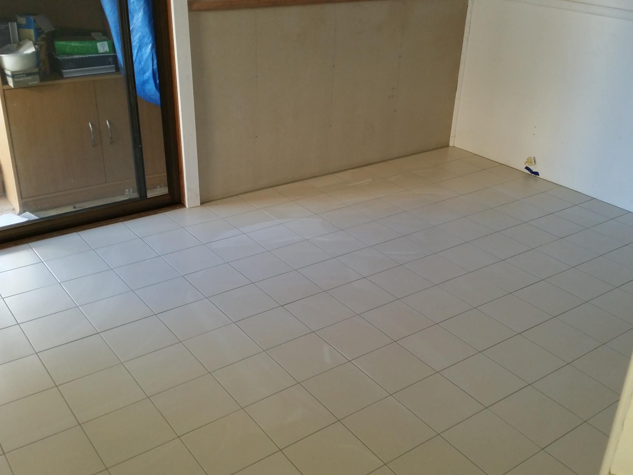 new rumpus room floor to match the bathroom off to the left