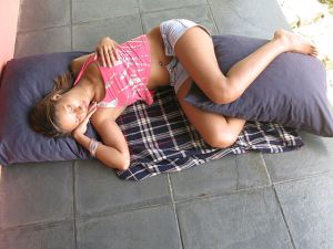 a woman sleeping on the floor - women need more sleep
