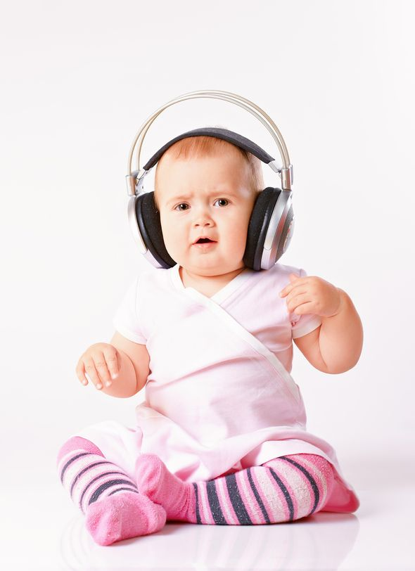 a baby girl wearing a headset