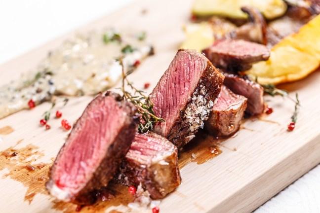 Beef steak on a wooden board, fine dining