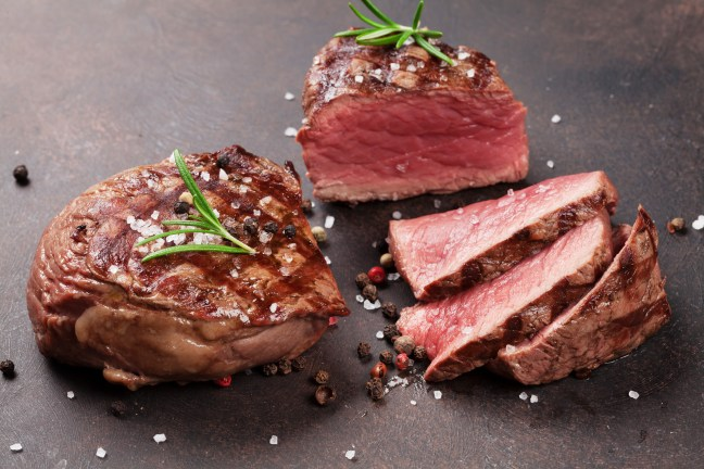 Grilled fillet steaks on stone table