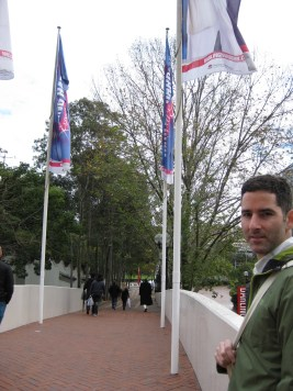 An unhappy looking Bryan (he loves it when I take pics) as we head over the pedestrian bridge towards the Olympic village