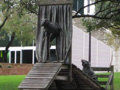 We had no idea what to make of this unusual statue, involving sheep walking a plank to jump from behind a curtain. Thoughts?