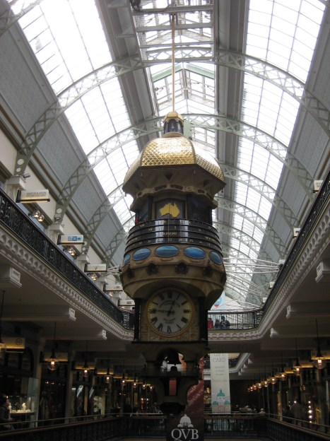 An ornate clock in the Queen Victoria Building