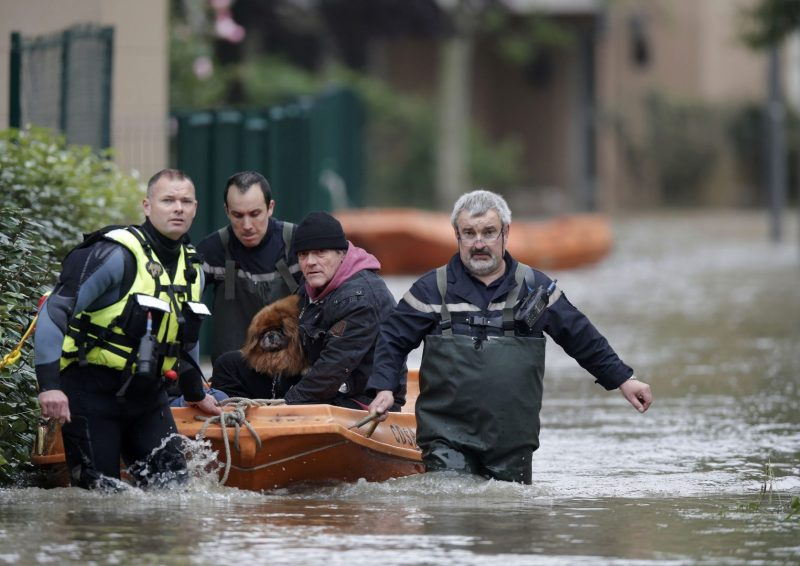 French firefighters on a small boat evacuate residents from a flooded area in Longjumeau, southern Paris, after days of almost non-stop rain caused flooding in the country, June 2, 2016. REUTERS/Christian Hartmann