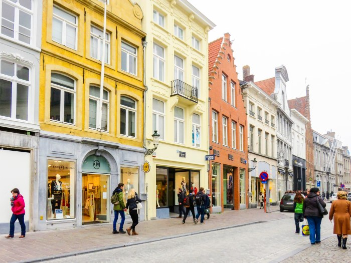colorful chocolate-box buildings and shops in bruges