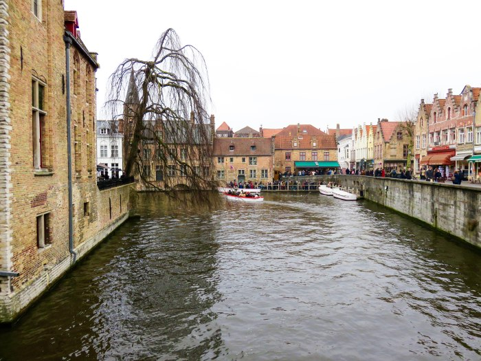 one of the main canals in bruges as seen from a bridge