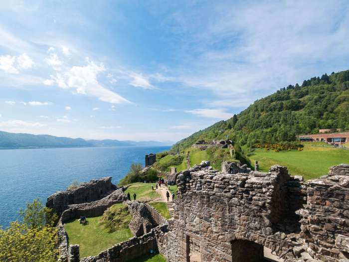 A view of Loch Ness from Urquhart Castle on a sunny day. Loch Ness is one of the main tourist attractions in Scotland and Urquhart Castle, a 13th century castle offers great views of the loch. #Scotland #Highlands #LochNess