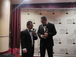 Eric Schwacke interviewing NY1 Reporter Roger Clark after his NY Emmy® award win. Photo: Meredith Arout for Life-Wire News Service.