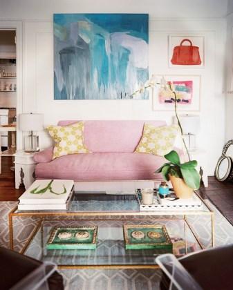 Living+Room+Artwork+hung+above+purple+couch+qOkzEfCquiRl