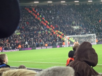 The orange is rows of police/security to ensure the fans don't mix and fight'