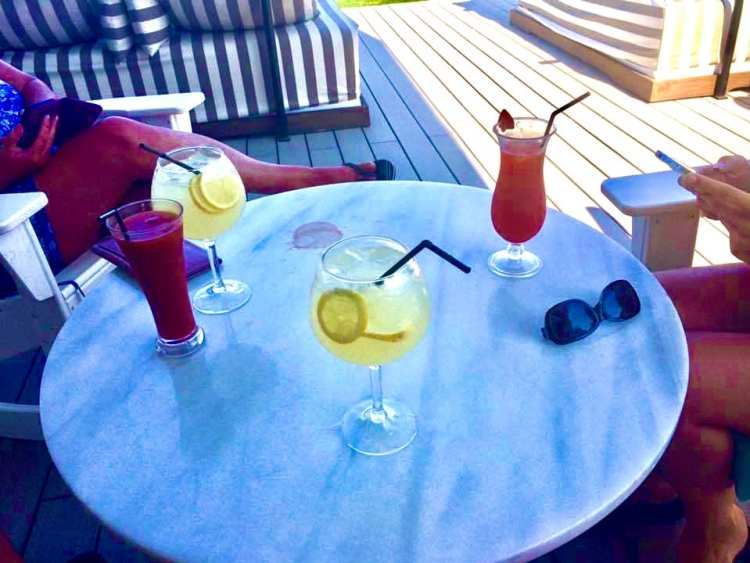 4 cocktails at a poolside bar to try and replicate for a home holiday
