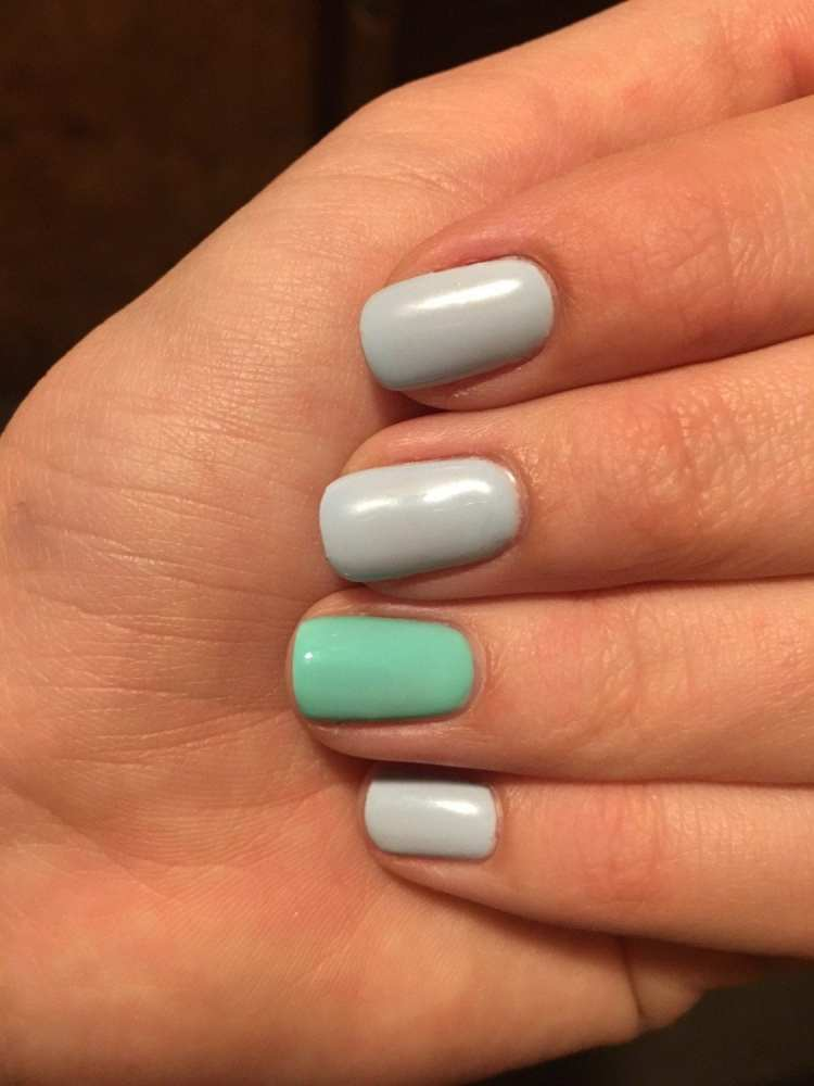 Home holiday nails - a diy manicure of pastel blue and mint green finger nails
