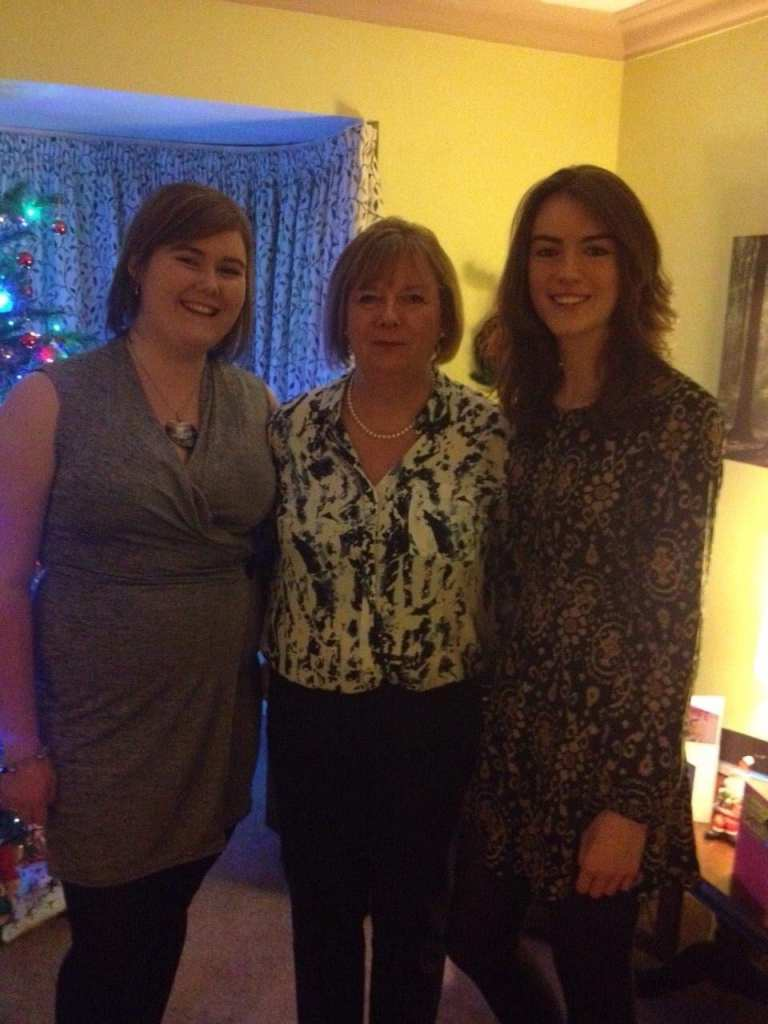 Left to Right: Me in a silver wrapover dress, Mum in a patterned blouse and trousers, and Rachel in a snake skin style dress