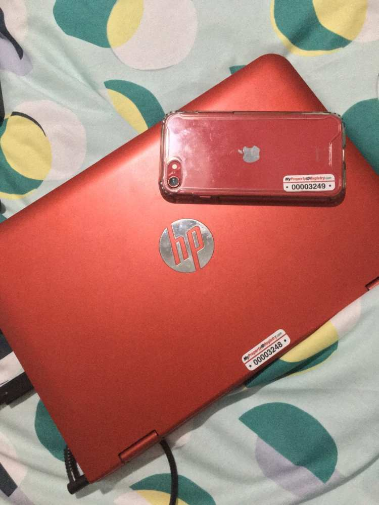 MyPropertyID tags on red laptop and iPhone