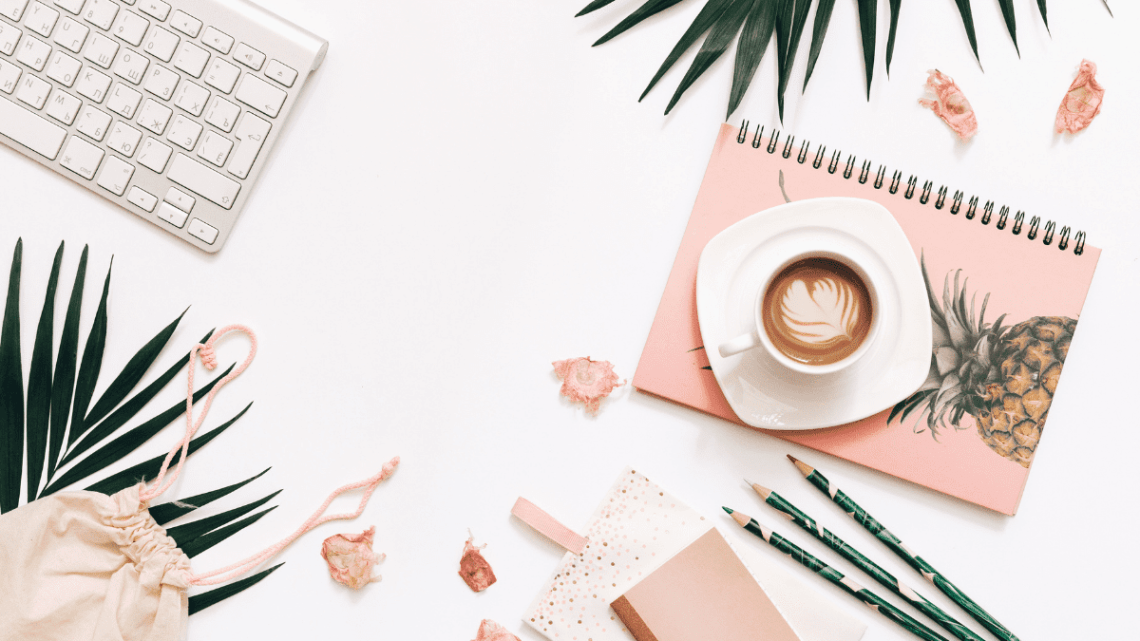 white background with pale pink blogger flatlay as part of blogger advertising packages blog post