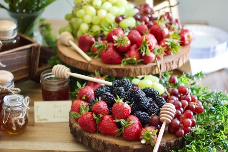 Fruit and honey display baby shower idea. Click to see even more food ideas from this Classic Winnie the Pooh baby shower!