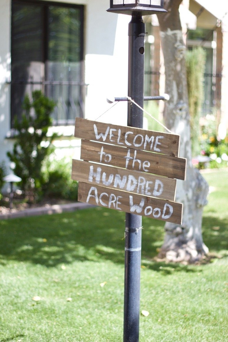 DIY Hundred acre wood sign for a classic Winnie the Pooh themed baby shower! Click to see more from this beautiful baby shower