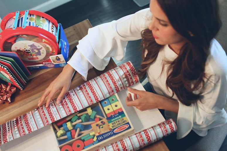Brunette woman wrapping Melissa and Doug classic playlet   toddler and baby christmas gift ideas   lifewithmar.com