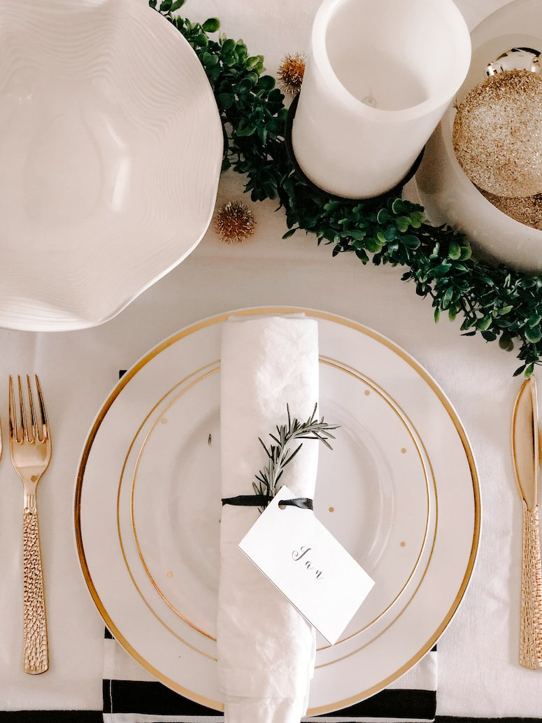 black white and gold table setting new year's eve tablescape idea