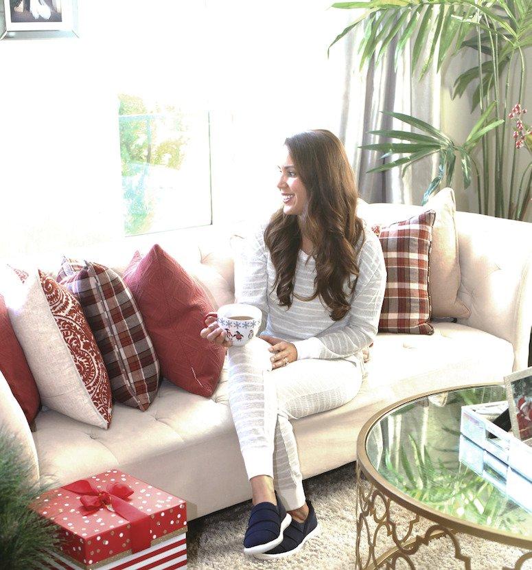 woman on sofa drinking tea