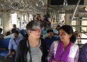 Riding the commuter train in Mumbai with our guide, Hemali Talsinia of Bravo Bombay.