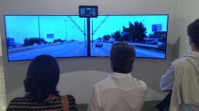 Sitting up high, above the traffic, with a giant window is a view only big truck and bus drivers enjoy. This video installation shares the thrill. Viewers are given the bus drivers seat traveling through California. The small screen shows the inside of the bus.