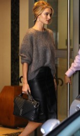Rosie Huntington Whitely in a black leather skirt and sweater