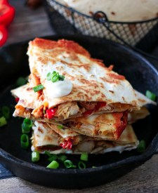 Chicken Fajita Quesadillas are a cheesy spin on a classic. Full of fajita veggies, tender chicken and lots of cheese these are perfect any night!